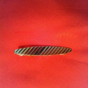 Gold colored tie bar
